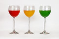 A variety of glasses with colored water three multi Royalty Free Stock Photography