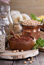 Variety of grains and beans on a wooden table Royalty Free Stock Photos