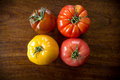 Variety heirloom tomatoes colorful juicy or heritage on wooden table Stock Image