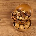 Variety of nuts mix hazelnuts peanuts walnuts pine close up selective focus Royalty Free Stock Photography