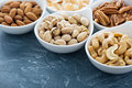 Variety of nuts in small bowls Royalty Free Stock Photo