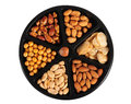 Variety of nuts on a tray against white background Royalty Free Stock Photography