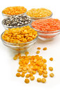 Variety of pulses close up different types split kept in glass container Stock Photos