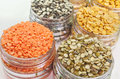 Variety of pulses close up top view different types displayed in plastic container Stock Photos