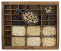 Variety of rice grains in vintage drawer Royalty Free Stock Photo
