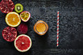 Variety of sliced fruit and freshly pressed juice Royalty Free Stock Photo