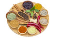 Variety of spices on wooden board isolated white Stock Photos