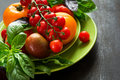 Variety of tomatoes and basil Royalty Free Stock Photo