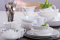 Variety of white dinnerware plates cups and bowls Royalty Free Stock Photo
