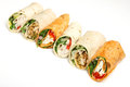 Variety of wrap sandwiches arranged in a line Royalty Free Stock Images