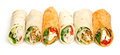 Variety of wrap sandwiches on white arranged in a row Stock Photos