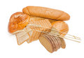Various bakery products and wheat spikelets on a light backgroun Royalty Free Stock Photo