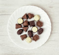 Various belgian pralines on the white plate Royalty Free Stock Photo