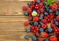 Various berries on a brown background Royalty Free Stock Images
