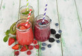 Various berry smoothies on a white background Royalty Free Stock Photo