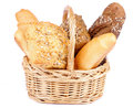 Various bread bunch of freshly baked in wicker basket isolated on white background Stock Photos