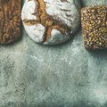 Top view of bread loaves over grey background, square crop Royalty Free Stock Photo