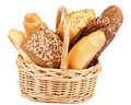 Various bread wicker basket with freshly baked isolated on white background Stock Image