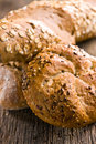 Various breads on old wooden background Stock Photography