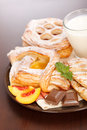 Various cakes and milk breakfast Royalty Free Stock Images