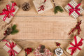 Various Christmas gift boxes and decoration on wooden planks background