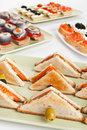 Various club sandwiches trays with a variety of canapes and with salmon and seafood Royalty Free Stock Image