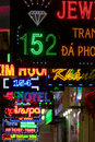Various colored commercial neon lights signs at night, Ho Chi Mi Royalty Free Stock Photo