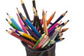 Various colored pencils standing in grilled pencil cup Royalty Free Stock Photo