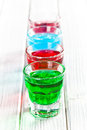 Various colorful liquors the on wooden table Royalty Free Stock Photo