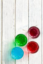 Various colorful liquors the on wooden table Royalty Free Stock Image