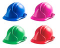 Various colors of hard hats on white background Stock Image