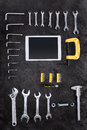 Various construction tools and digital tablet on black Royalty Free Stock Photo