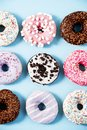 Various donuts on a colorful background. Top view shot. Royalty Free Stock Photo