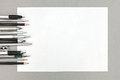 Various drawing tools and blank sheet of paper on gray office de Royalty Free Stock Photo
