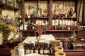 Various flasks, jars and herbs on the shelves  in old pharmacy Royalty Free Stock Photo