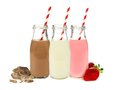 Various flavors of milk in bottles Royalty Free Stock Photo
