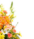 Various flowers arranged in basket on white Stock Image