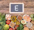 Vitamine E food sources, top view on wooden background Royalty Free Stock Photo