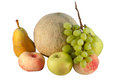 Various fresh fruit summer apple melon grapes pears and peaches on white background Royalty Free Stock Image