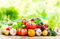 Various fresh vegetables on wooden table Royalty Free Stock Photo