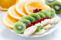 Various fruit on a plate orange kiwi banana Royalty Free Stock Photo