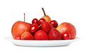 Various fruit on a plate side view isolated white background Royalty Free Stock Photo