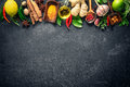 Various herbs and spices on black stone plate Royalty Free Stock Photography