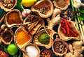 Various herbs and spices on wooden table Stock Photos