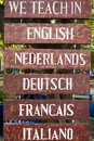 Various languages education signpost in Indonesia Royalty Free Stock Photo
