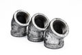 Various metal fittings inner for pipes on white equipment water pipe joints Royalty Free Stock Photo