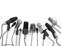 Various microphones aligned at press conference Royalty Free Stock Photo