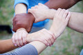 Various persons holding hands Royalty Free Stock Photo