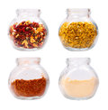 Various seasonings in glass jars  isolated Royalty Free Stock Photo