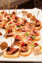 Various snacks in plate on banquet table close up Stock Photos